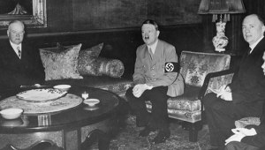 Former president Hoover at the Reich Chancellery with Chancellor Adolf Hitler and Hugh Wilson. 31-1938-29