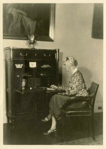 """ou Henry Hoover sitting at the """"Monroe Desk"""" -  that was reproduced for the White House collection. ca 1931"""