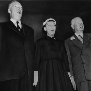 President Dwight Eisenhower, First Lady Mamie and former president Herbert Hoover, singing at the Republican Lincoln Dinner - 02/05/1954.