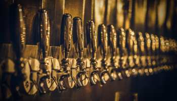 Row of beer taps. Photo taken by Charlie Solorzano