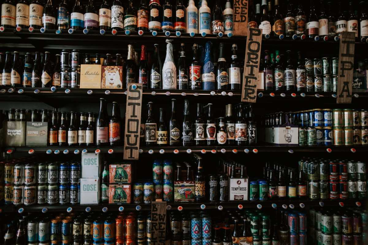 Wall of beer bottles at Whichcraft Austin