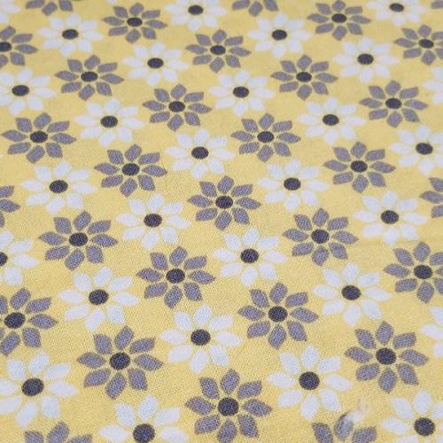 grey_white_daisies_on_yellow_bg