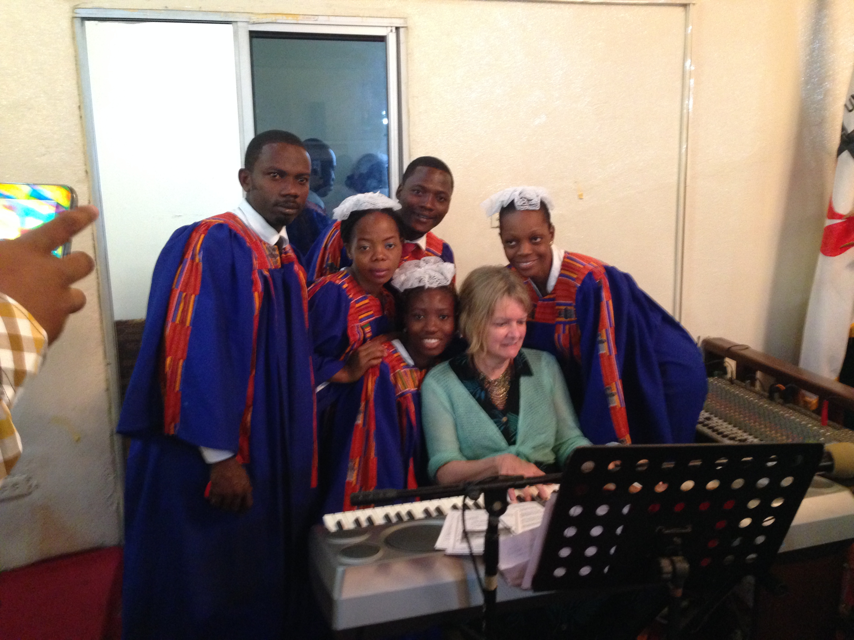 After the service, some the choir surrounds Julie for photos!