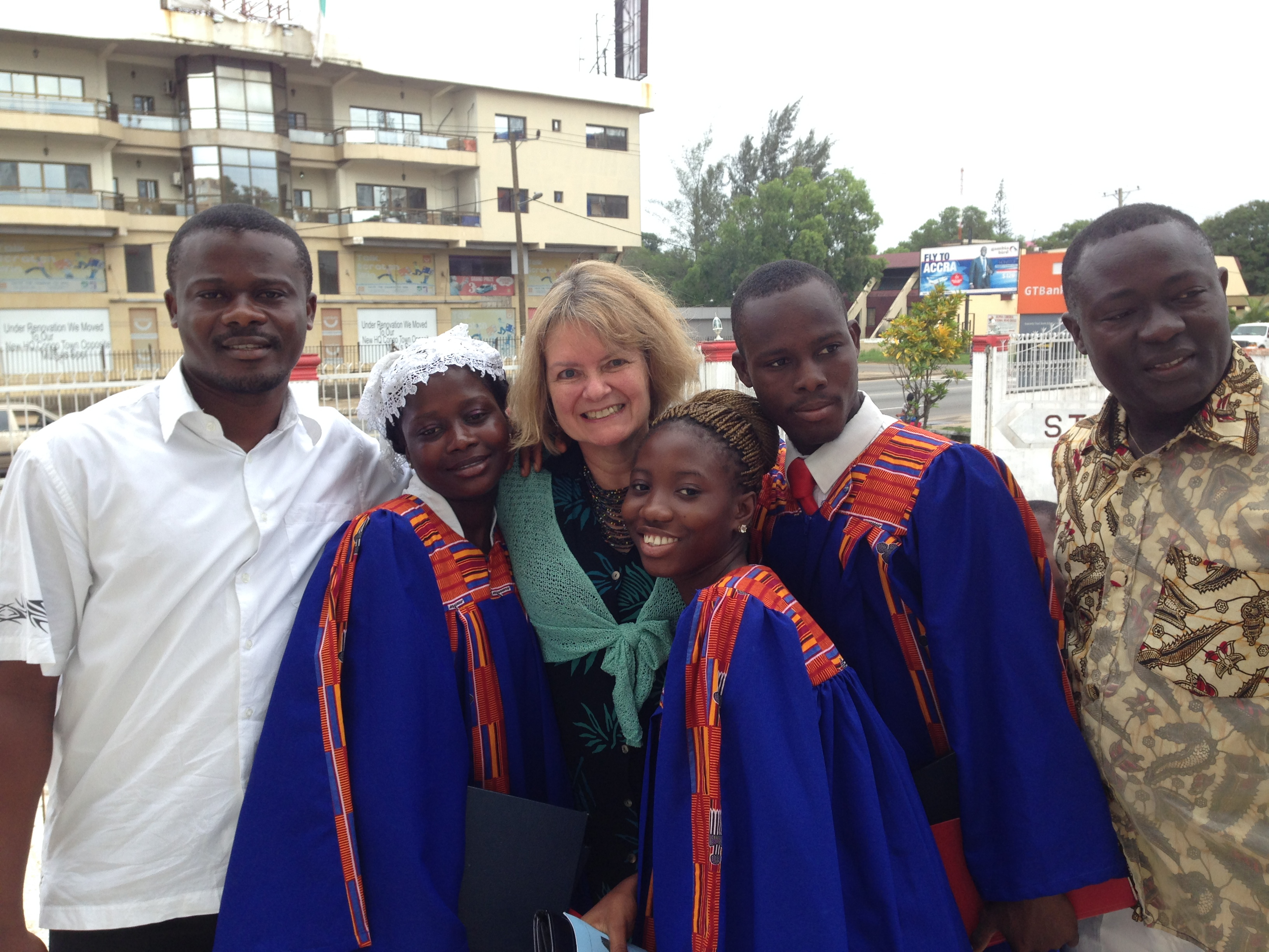 Sam, Julie, some of the choir, and the choir director, Sawie Davies.