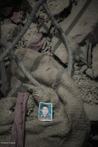A passport photo found between the roubles during the rescue operation.