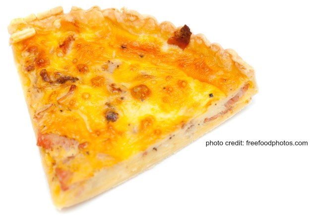 Slice of tasty golden fresh savoury egg quiche isolated on a white background