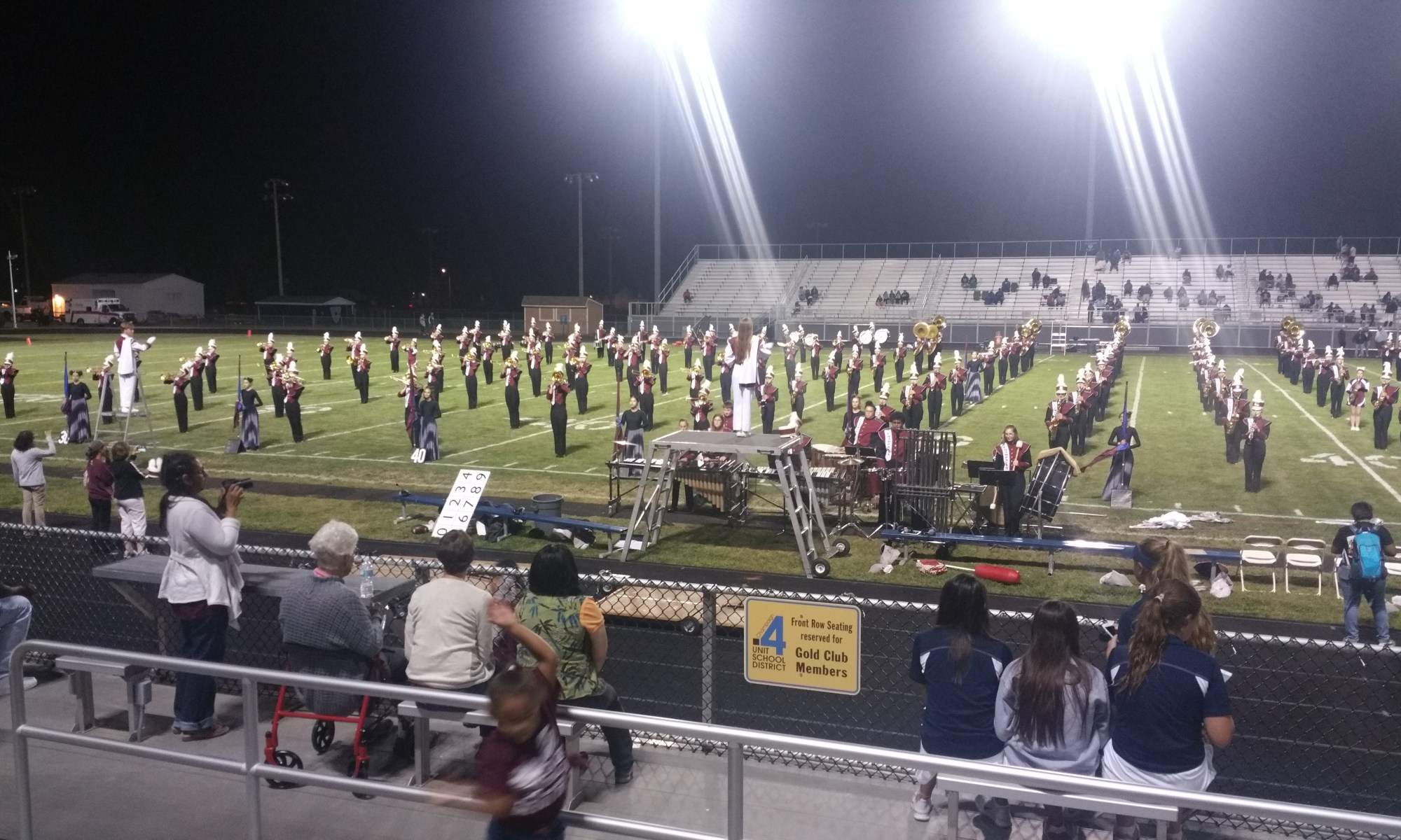 Marching band on field being abducted by aliens.