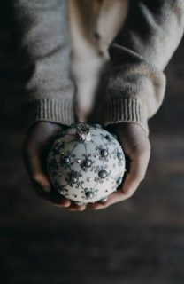 Holding Christmas Ornament