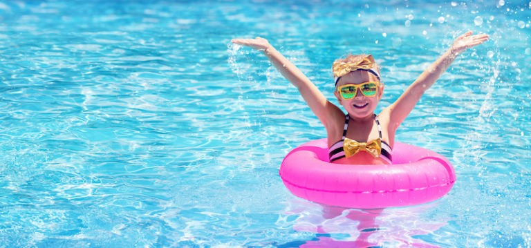 Happy Child Swimming In The Pool