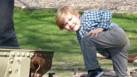 Oliver climbing on tank at Cantigny park