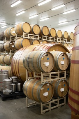 Barrels stacked inside the Cascade blending facility.