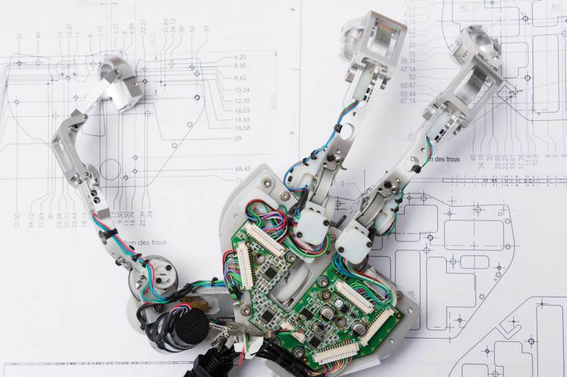 The three-fingered hand exoskeleton developed by CEA captures the operator's movements to control the slave robot hand. Image Credit - CEA / Stroppa