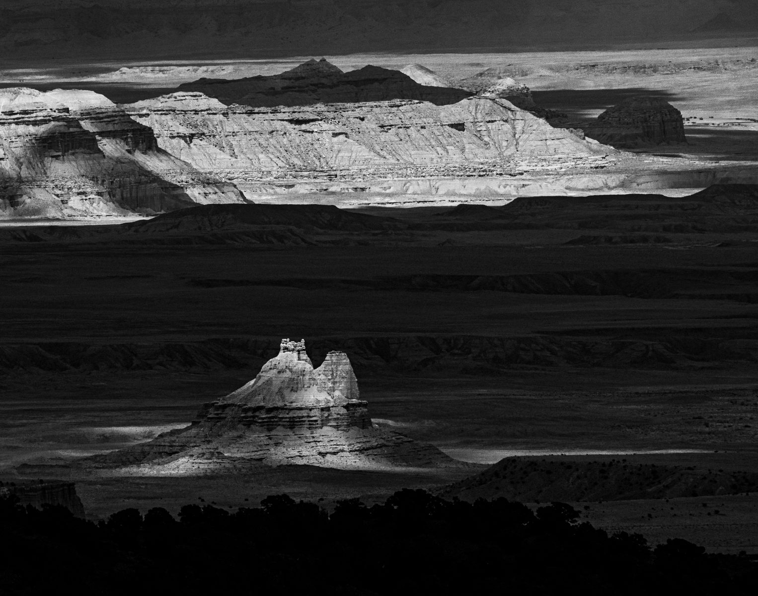 Capitol Reef National Park photo tour. Light and shadow on a landscape with desert butte.