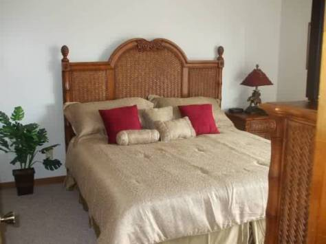 Master  bedroom has king bed, balcony, and private bath