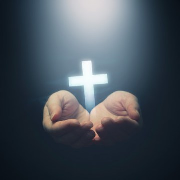 27119899 - open hands holding cross, symbol of christian faith