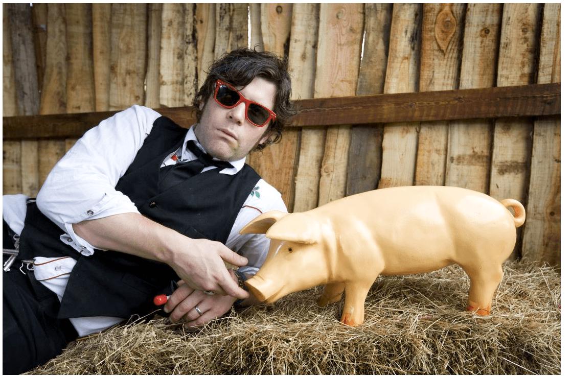 Ed Harcourt and piglet model at Glastonbury
