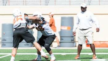 Coach Strong watches over 1 on 1 drills at the 2014 Texas Football Fan Day (photo: Jesse Drohen)