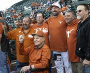 Coach Gus with fans and past players-