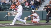 Texas alum Tres Barrera-now with the Champion Washington Nationals-at the plate with a big swing!