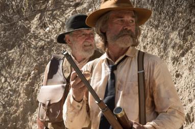 "(L-R): Richard Jenkins as Chicory and Kurt Russell as Sheriff Franklin Hunt in the western film ""BONE TOMAHAWK"" an RLJ Entertainment release. Photo credit: Scott Everett White."