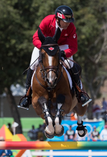 Canada's Eric Lamaze aboard his horse Fine Lady 5 competes during Equestrian Individual Jumping Final Round A at the Olympic games in Rio de Janeiro, Brazil, Friday August 19, 2016. COC Photo/Mark Blinch