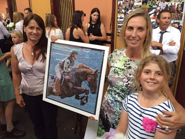 LIsa Purcell presents the finished mosaic to Olivia's mum and sister