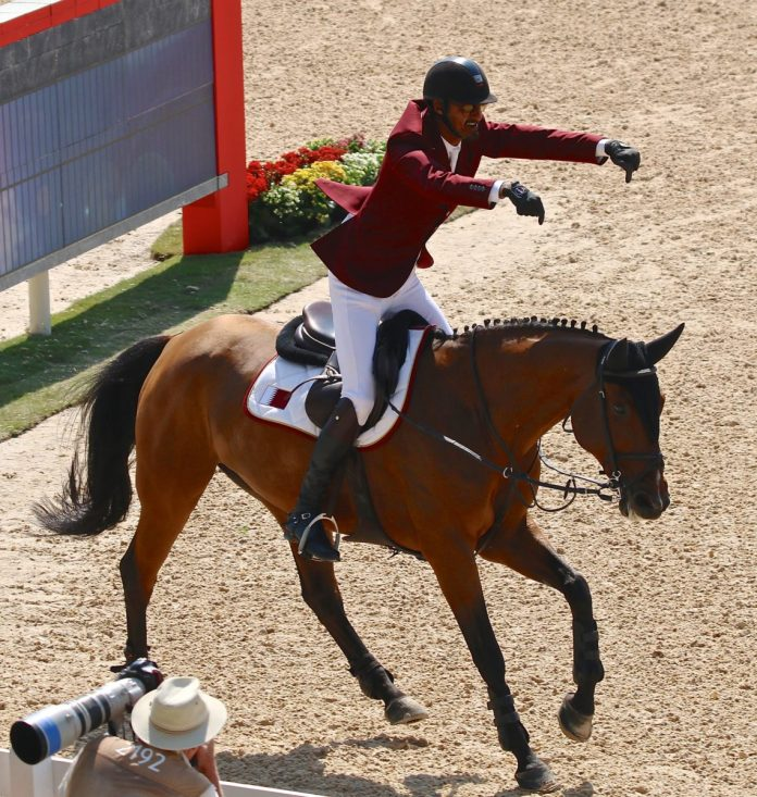 Sheik Ali Al Thani is very delighted with his horse, First Devision (Image: Jane Thompson)