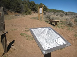 Two signs in Horse Gulch with the same map on each one, within feet of each other. They were paid for and installed by Trails 2000.