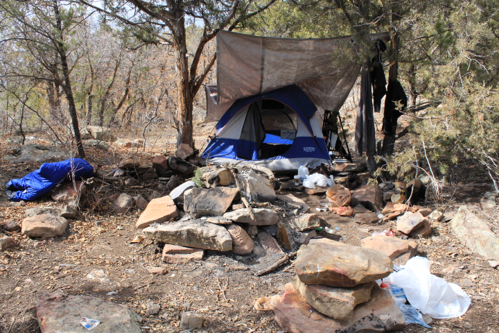 Here's someone's camp off of Raiders Ridge. It's totally trashed with everything from food packaging to human fecal matter and used toilet paper.