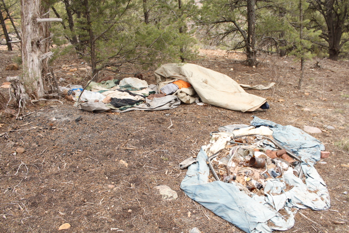 Plenty of trash in this camp on City-owned open space land.