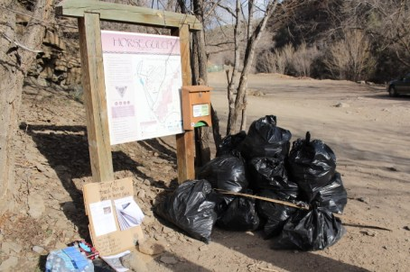 Trash removed from Horse Gulch on Sunday afternoon sits in a big heap at the trail head.