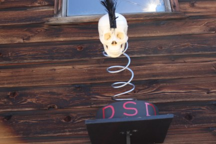 A non-traditional business sign out front at Diaz Suspension Designs.