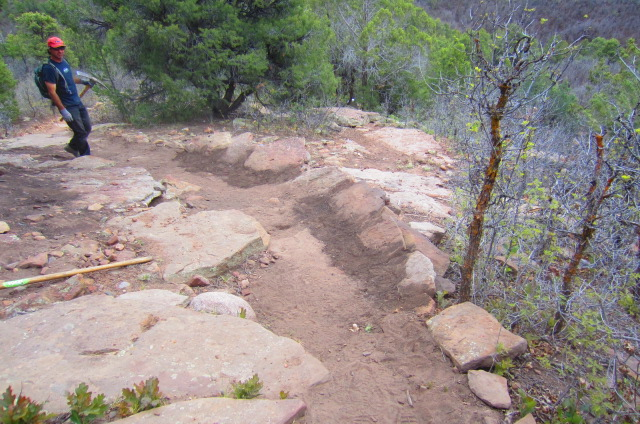 This rock berm was constructed out of sandstone slabs and dirt. Can't wait to ride it!