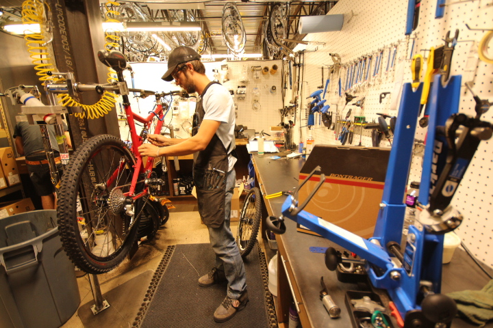 Mechanic Cody Gray works on a Santa Cruz Superlight at Second Avenue Sports.