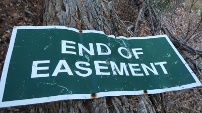 This sign was nailed to a cottonwood tree that had fallen over by Falls Creek Road. The sign appeared to be on the Zink's 30-acre parcel.