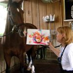 "Mary Simons of ReRun Thoroughbred charity asked Jamaica and his teammate Rolex to help raise money for charity by painting masterpieces known as ""Moneighs.""  (Photo courtesy of ReRun, Inc)"