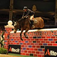 Winners Luca Moneta & Quovo de Vains clear the 7 ft. 2 in. Puissance wall
