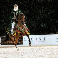 Cathy Vecsey and HL Sanction on their way to winning the Native Costume Class