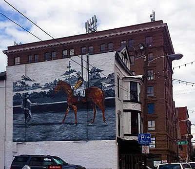Man o' War Commemorative Mural Painted on The Village Idiot