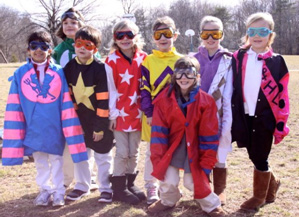 Kids in the Kentucky Horse Park Literacy Program trying on jockey silks.