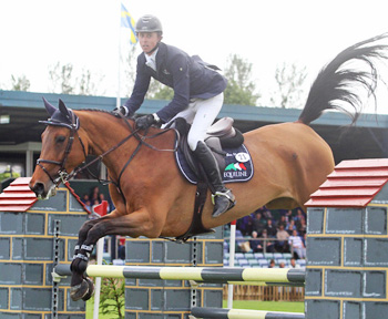 Ben Maher and Parvati De Breve win the LED Sports Europe Hickstead Master's Challenge.