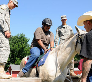 Soldiers from The Old Guard assist with the equine therapy program at the Caisson barn and stable on Fort Belvoir, Virginia.