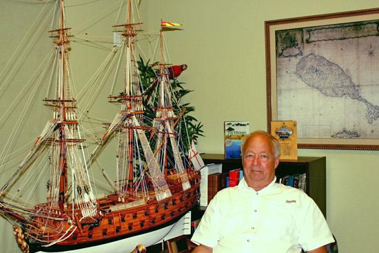John Amrhein, Jr. with model of La Galga built by his partner Bill Bane. La Galga played a pivotal role in both Misty of Chincoteague and Treasure Island.