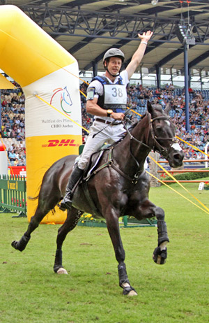 Chris Burton and Underdiscussion zoom to victory at Aachen.