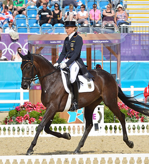 Germany's Ingrid Klimke and Butts Abraxxas lead after the first day of eventing's dressage phase at Greenwich Park.