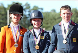 Individual jumping winner Millie Allen (GBR) is flanked by silver medalist Lisa Nooren (NED) and Alex Chitty (GBR), who won bronze.
