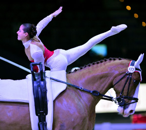 Italy's Anna Cavallaro and Harley, lunged by Nelson Vidoni, winners of the second leg of FEI World Cup™ Vaulting in Salzburg (AUT). (Photo: Daniel Kaiser/FEI)
