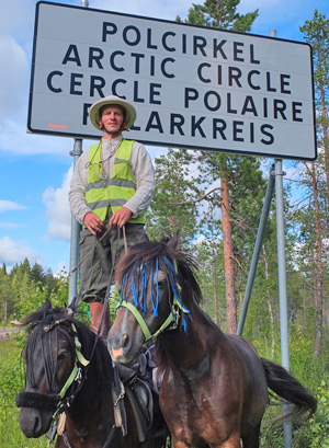 Vaidotas Digaitis and his horses Kredas and Kaklys at the Arctic Circle.