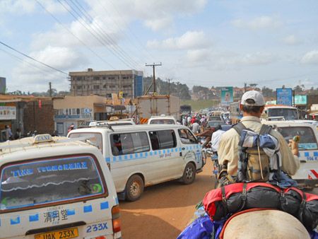 Billy riding through traffic in Kampala. Traffic, in one form or another, tests every Long Rider. Upon reaching Kampala, Billy and Christy were forced to thread their way though a hostile motorized environment.