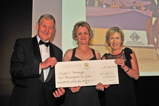 David Buckton a nd Di Arbuthnot present Vicky Smart with the winner's cheque for Roger's Revenge.